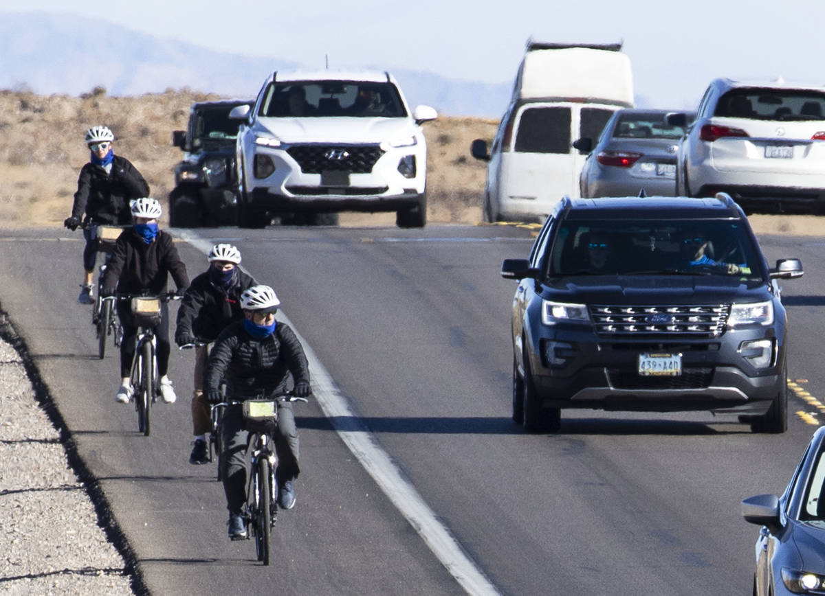 Cyclists ride their bike along the Charleston Blvd near Red Rock, on Tuesday, Dec. 29, 2020, in ...