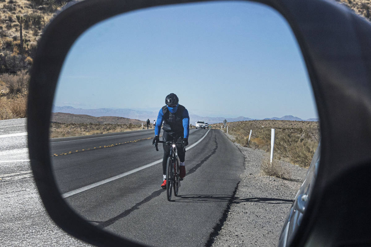A cyclist rides his bike along the Charleston Blvd near Red Rock, on Tuesday, Dec. 29, 2020, in ...