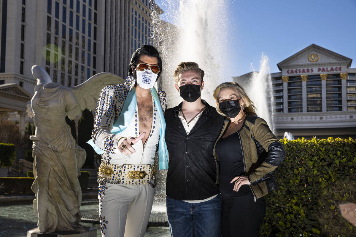 Cole Davis Duffy, center, poses with his dad, Brendan Paul, left, and his mom, Dee Dee Duffy, a ...