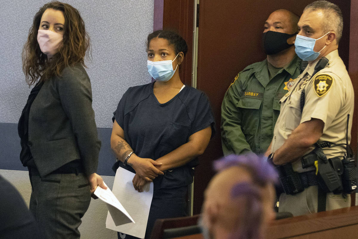 Amanda Sharp-Jefferson, second left, charged with murder in connection with the death of her 1- ...