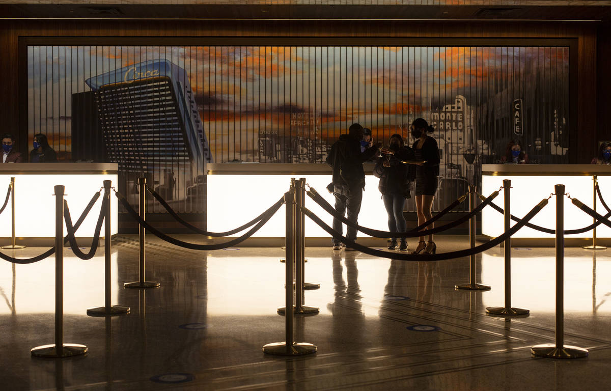 Guests are offered champagne as they check in for their stay at Circa on Monday, Dec. 28, 2020, ...