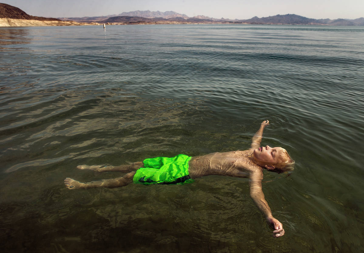 Lucas Schoon, 10, of Glenwood Springs, Colorado, floats at Boulder Beach while joining family a ...