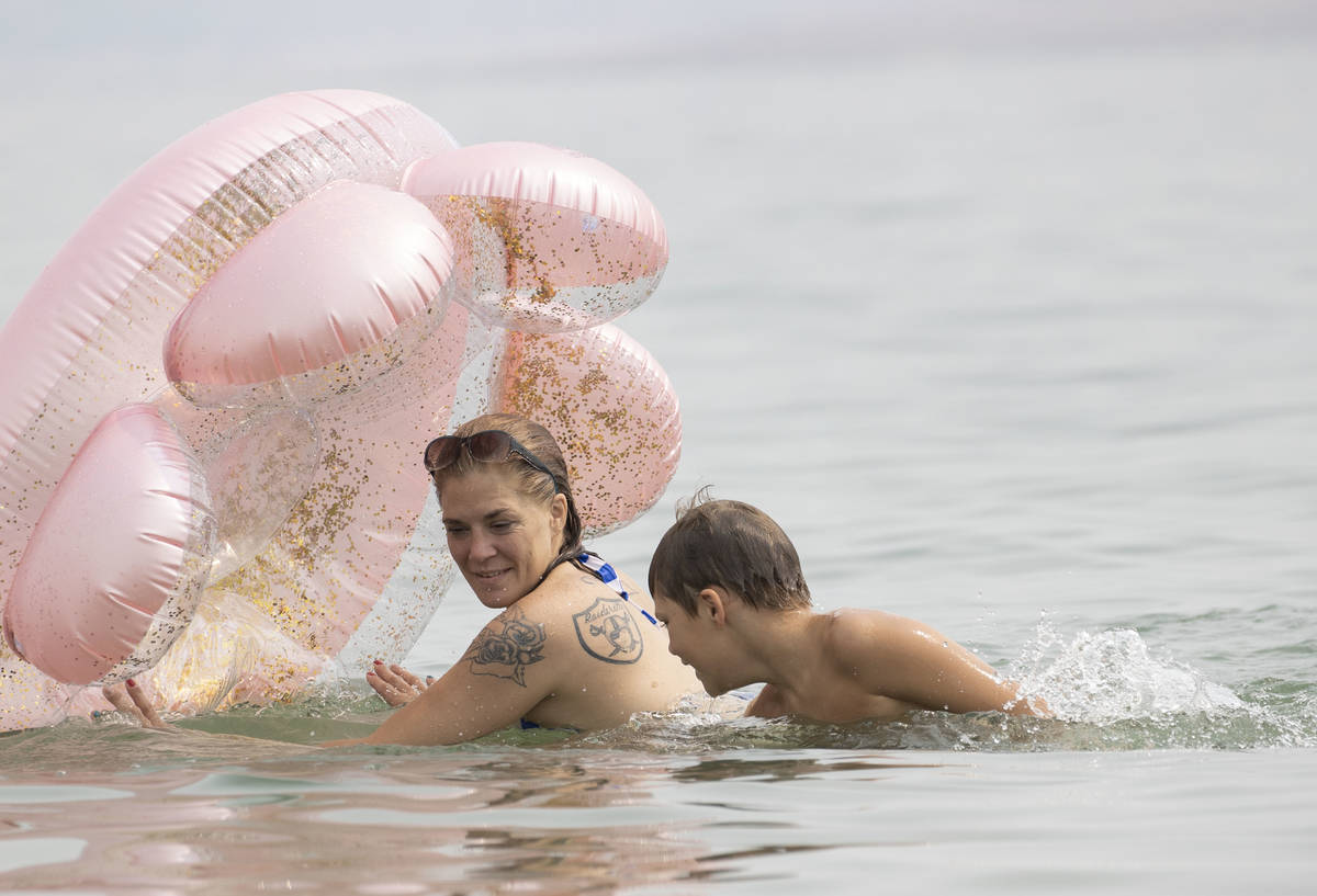 Stephanie Murphy plays with her son Aiden, 9, Both of Las Vegas, at Boulder beach in the Lake M ...