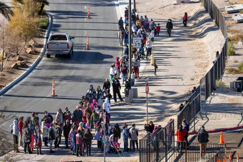 People line up to walk in as the Las Vegas Rescue Mission holds its toy drive on a first-come, ...