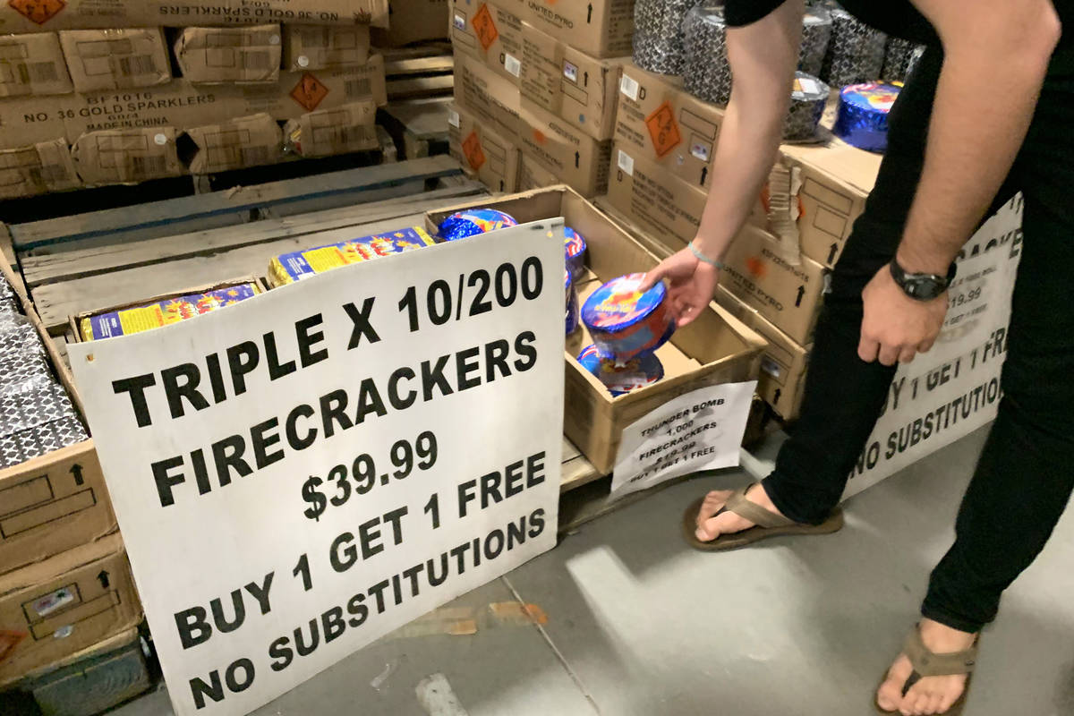 People shop for fireworks at Moapa Paiute Travel Plaza in Moapa on Tuesday, Dec. 29, 2020. (Eli ...