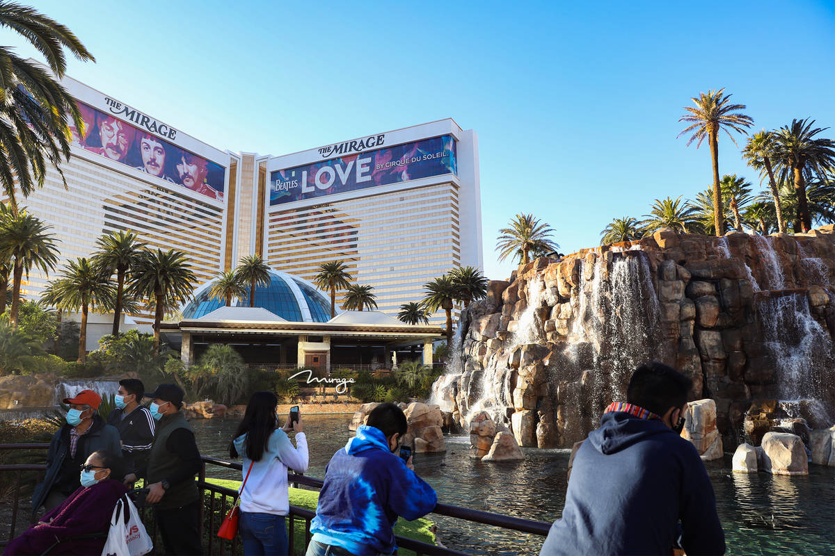 Visitors hang out in front of The Mirage on the Las Vegas Strip, Dec. 21, 2020. (Rachel Aston/ ...