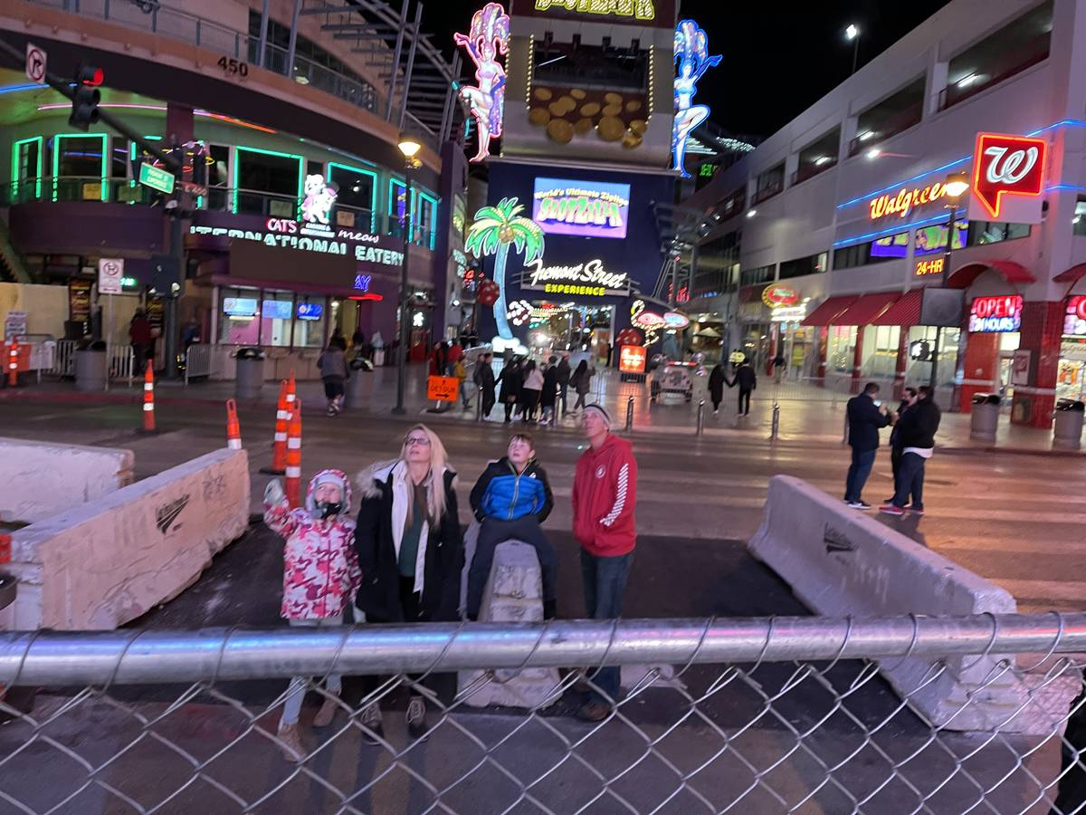 People wait on Fourth Street to watch the Fremont Street Experience light show on New Year's Ev ...