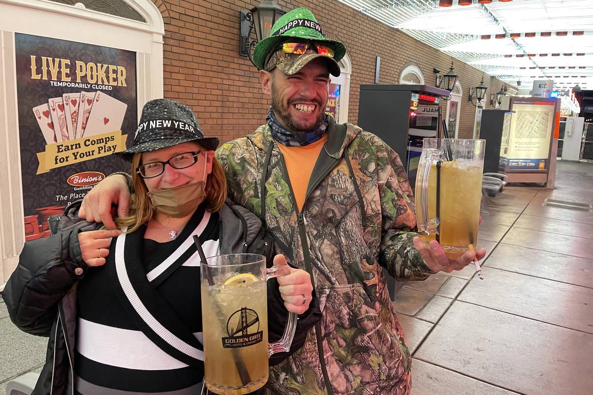 Josh and Emily Watson of Coffee, Tenn., who just got married Wednesday night, celebrate New Yea ...