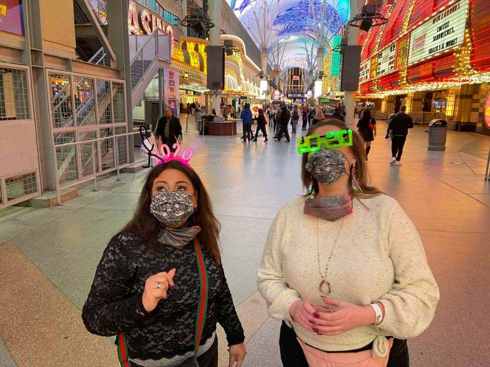 Erum Shahzad, left, and Natalie Melton, both of Dallas, celebrate New Year's Eve at the Fremont ...