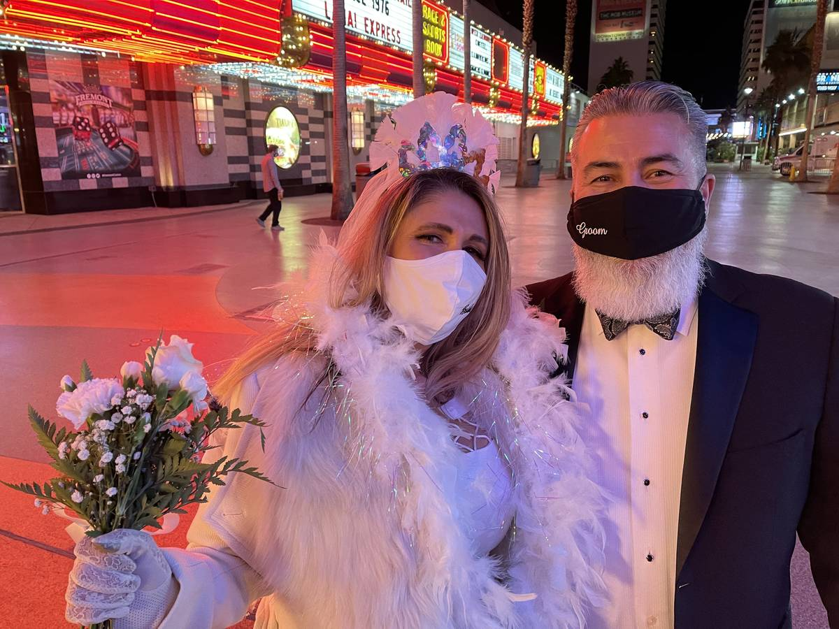 Just married couple Martha and Robert Pacheco of Las Vegas celebrate New Year's Eve at the Frem ...