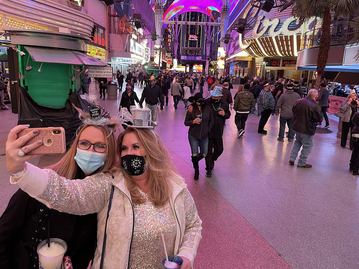 Sisters Christine, left , and Rebecca Loffert celebrate New Year's Eve at the Fremont Street Ex ...