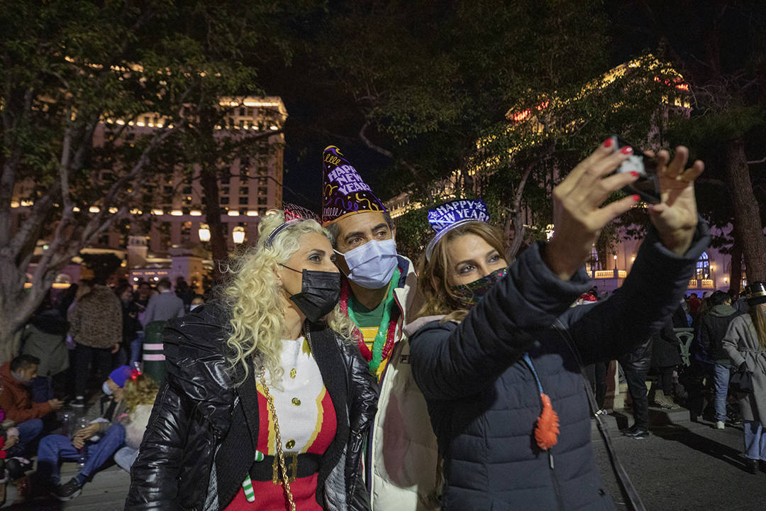 Karmella and Edmond Varpanin, left, and Stella Khania take a photograph while celebrating New Y ...