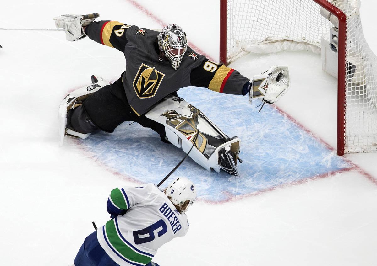 Vancouver Canucks' Brock Boeser (6) is stopped by Vegas Golden Knights goalie Robin Lehner (90) ...