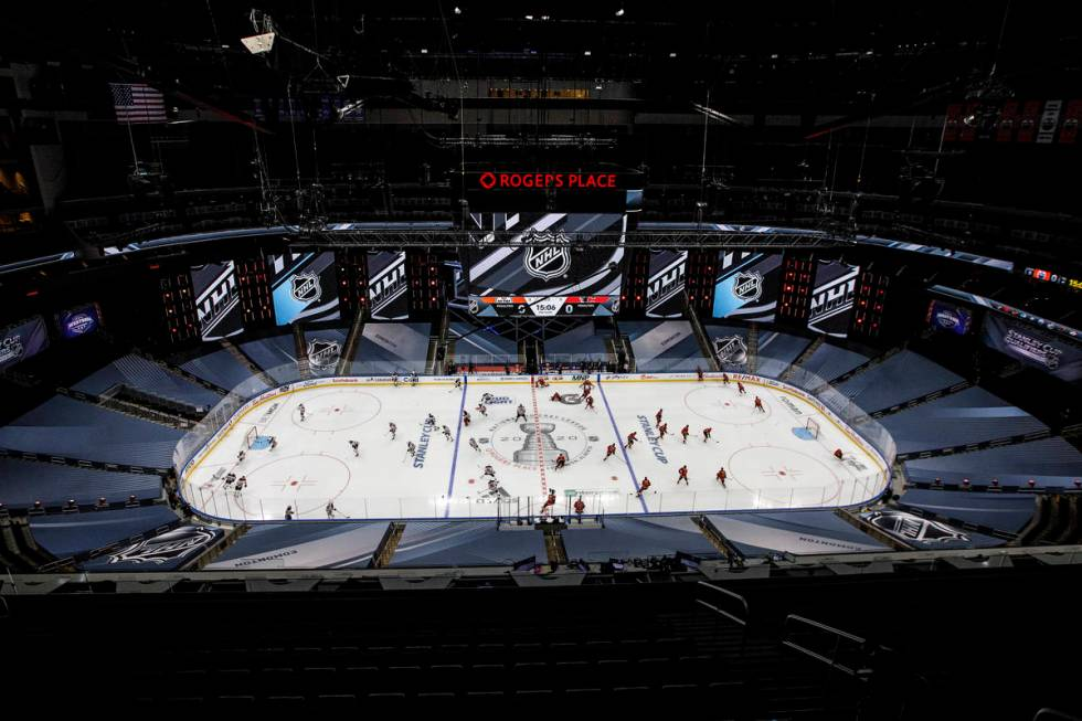 Edmonton Oilers and the Calgary Flames players warm up prior to an exhibition NHL hockey game T ...