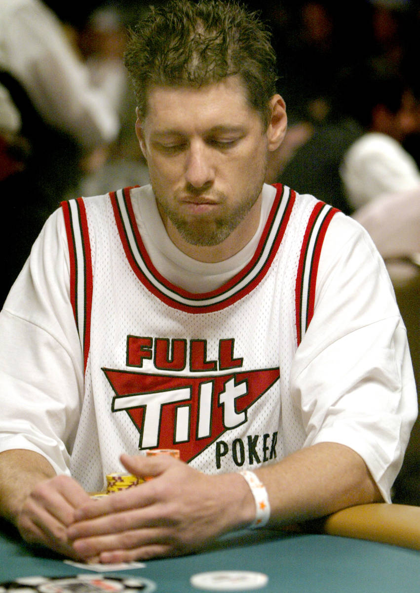 JANE KALINOWSKY/REVIEW-JOURNAL Huck Seed glances at his hand during the World Series of Poker ...