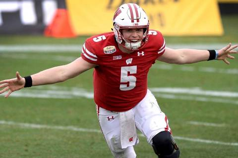 Wisconsin quarterback Graham Mertz celebrates they defeated Wake Forest in the Duke's Mayo Bowl ...