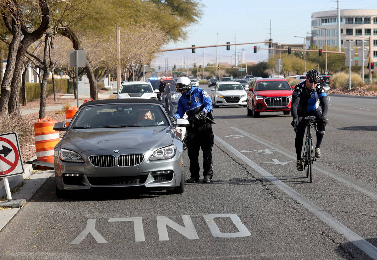 Police officers, including a North Las Vegas Police officer, front, pull over motorists as Sgt. ...