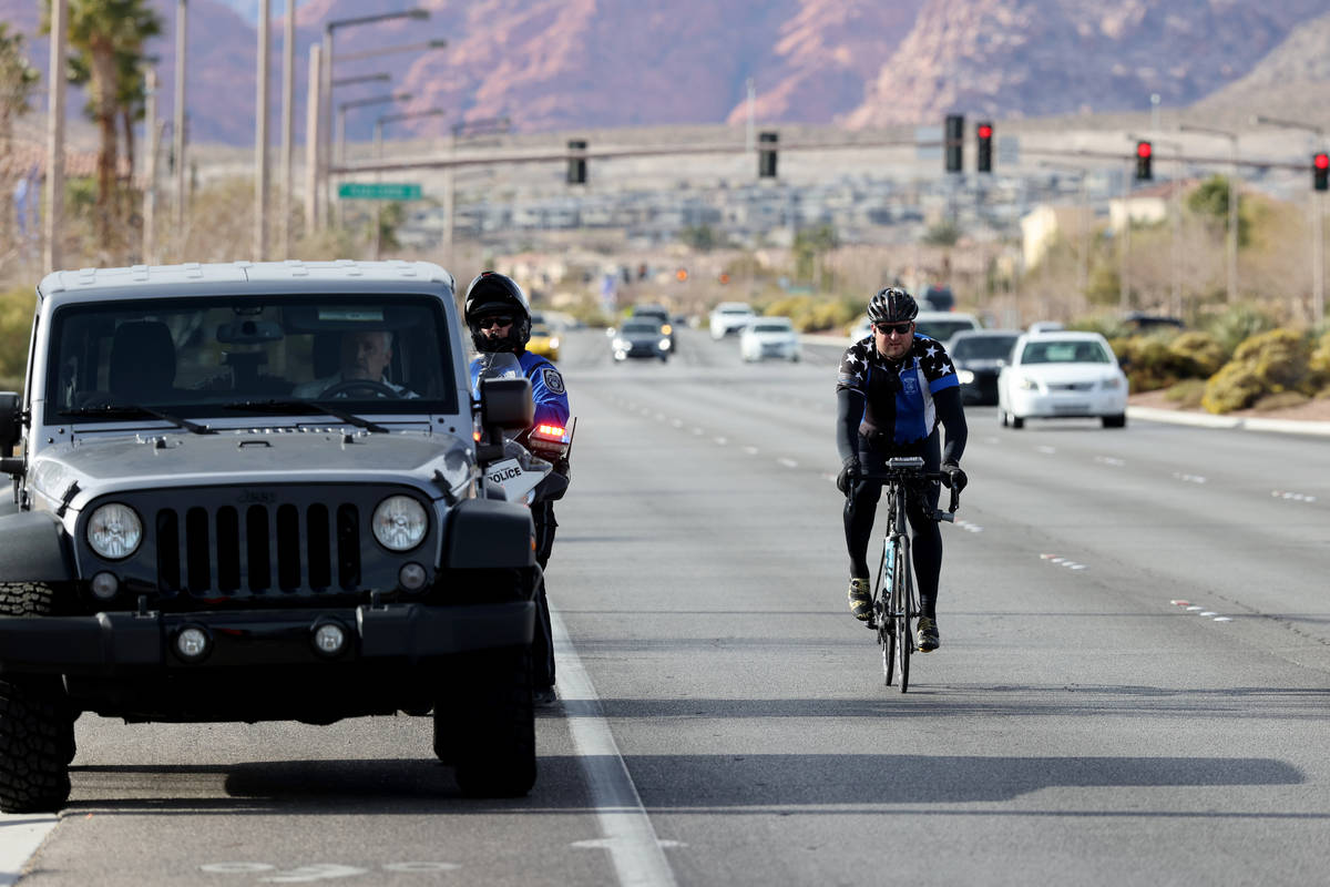 A North Las Vegas Police officer pulls over a motorist as Sgt. Michael Campbell, a traffic serg ...