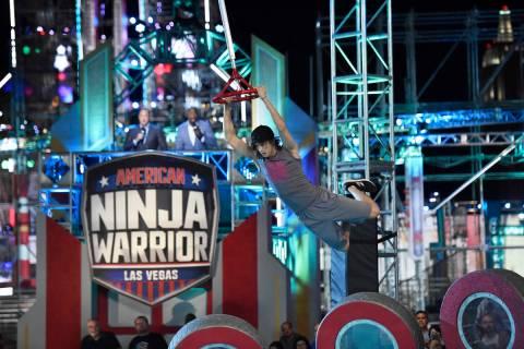 "Mathis ""Kid"" Owhadi runs the ""American Ninja Warrior"" course in Las Vegas. (David Becker/NBC)"
