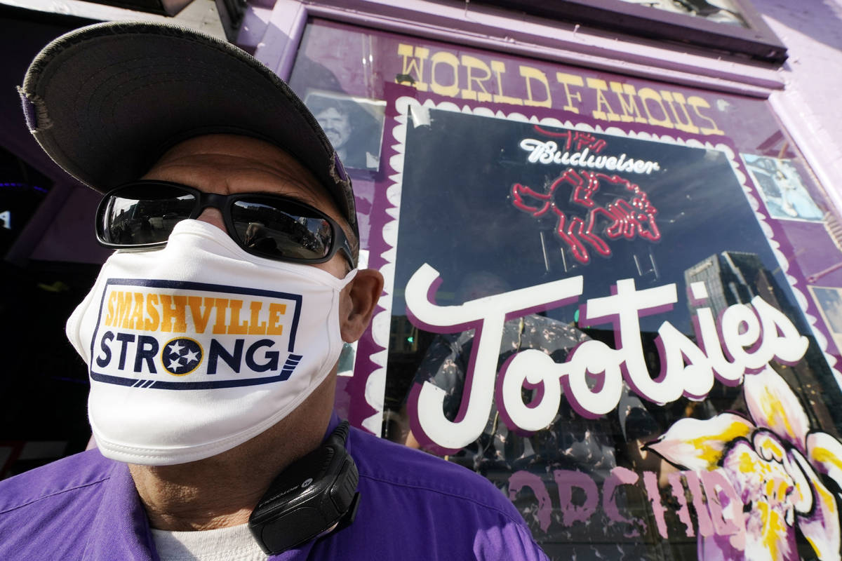 Jeffrey Susan, a security guard at Tootsies Orchid Lounge, wears a Nashville Strong face mask a ...