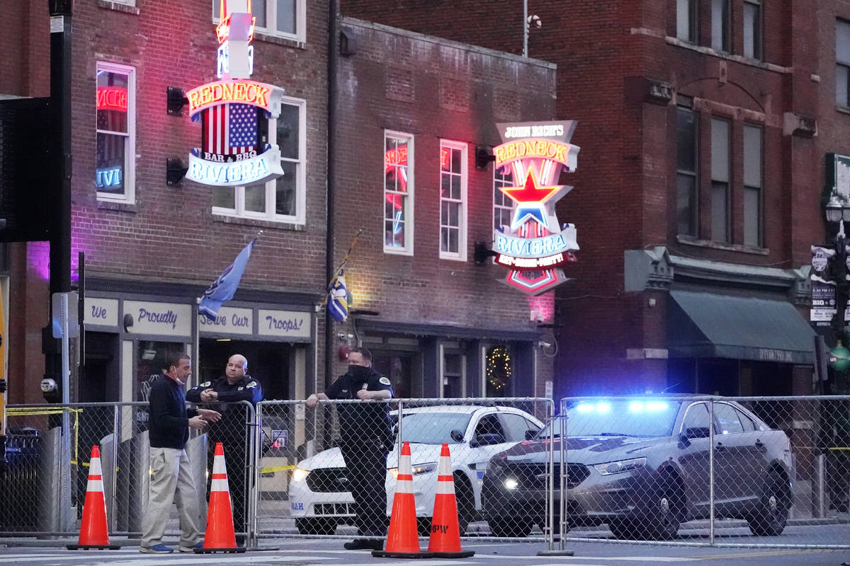 Police block off a part of the Broadway tourist district Monday, Dec. 28, 2020, as a result of ...