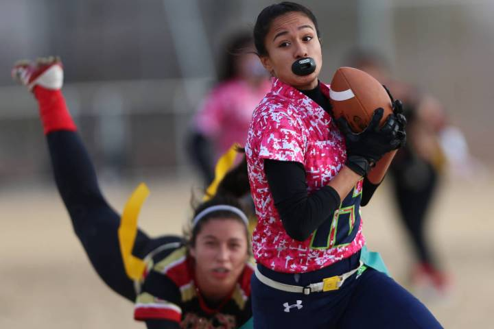 Green Valley junior Jazlyn Camacho (15) makes an interception against SECTA in the flag footbal ...