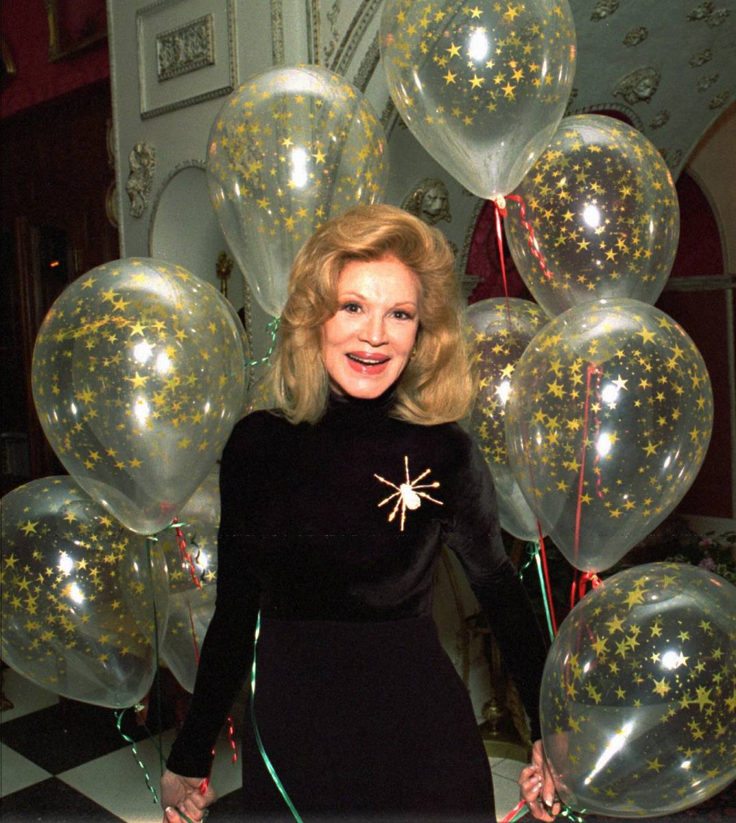 Singer Phyllis McGuire smiles after receiving a cluster of balloons at her Las Vegas home Dec. ...