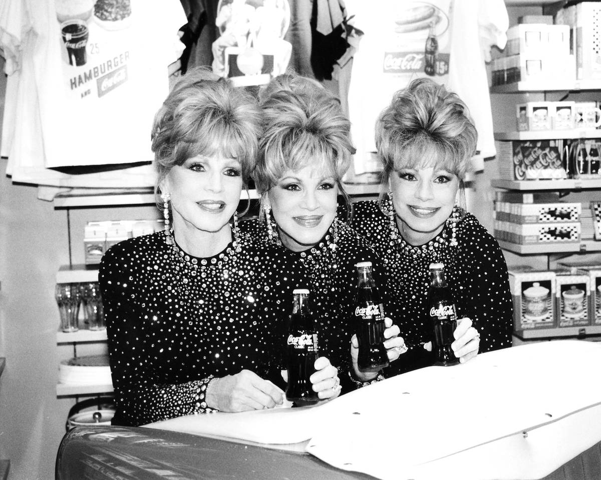 The McGuire Sisters, Christine, Phyllis and Dorothy, at the opening of the World of Coca Cola o ...