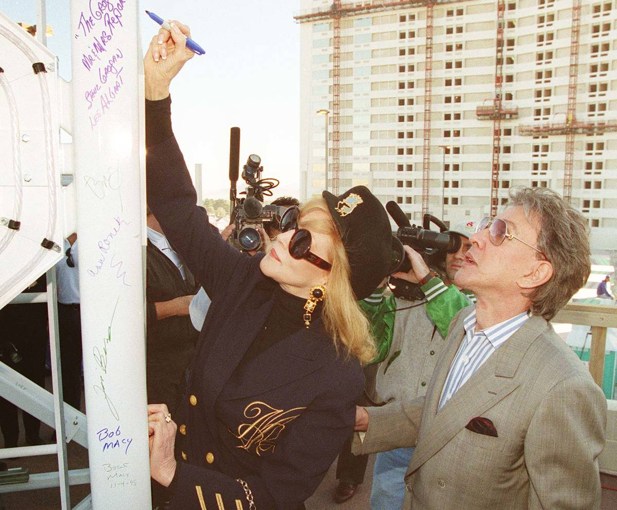 Phyllis McGuire signs the top spire of the Stratosphere Tower before it was placed on Nov 4, 19 ...