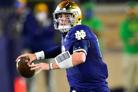 Notre Dame quarterback Ian Book looks for a receiver during the first quarter against Clemson i ...