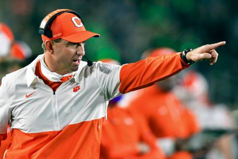 In this Saturday, Nov. 7, 2020, file photo, Clemson coach Dabo Swinney signals to his players d ...