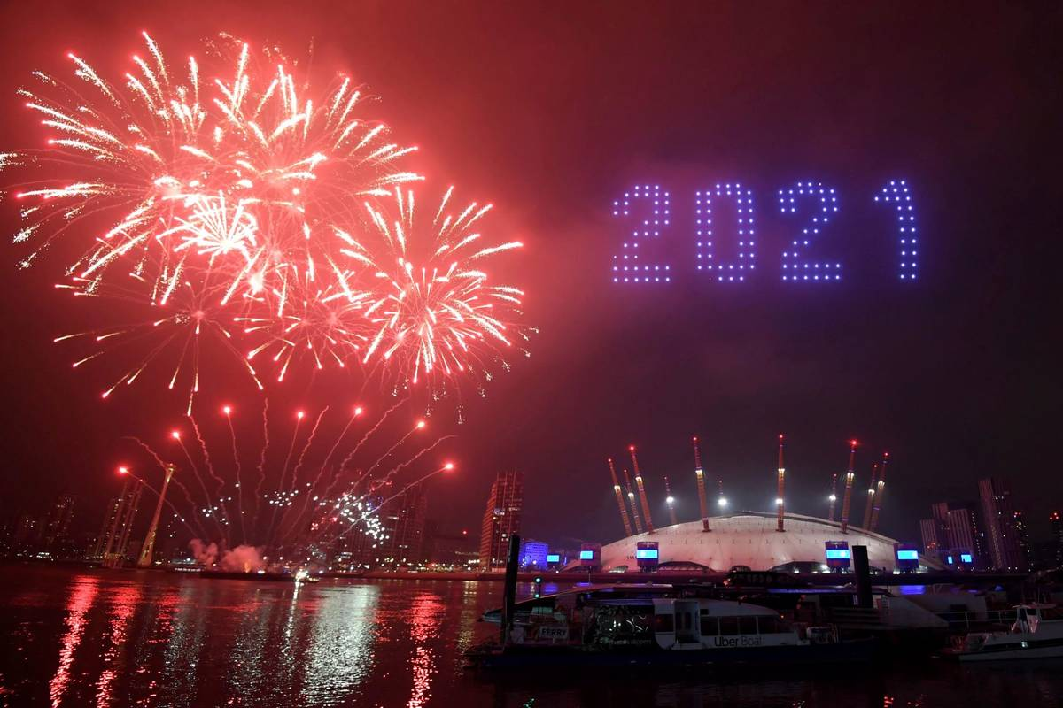 Fireworks and drones illuminate the night sky over London as they form a light display as Londo ...