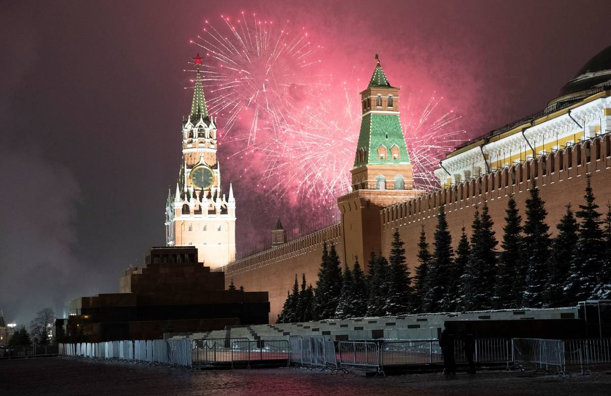 Fireworks explode over the Kremlin and almost empty Red Square during New Year's celebrations n ...