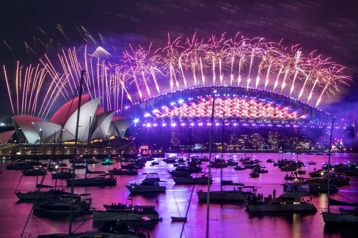 Fireworks explode over the Sydney Opera House and Harbour Bridge as New Year celebrations begin ...