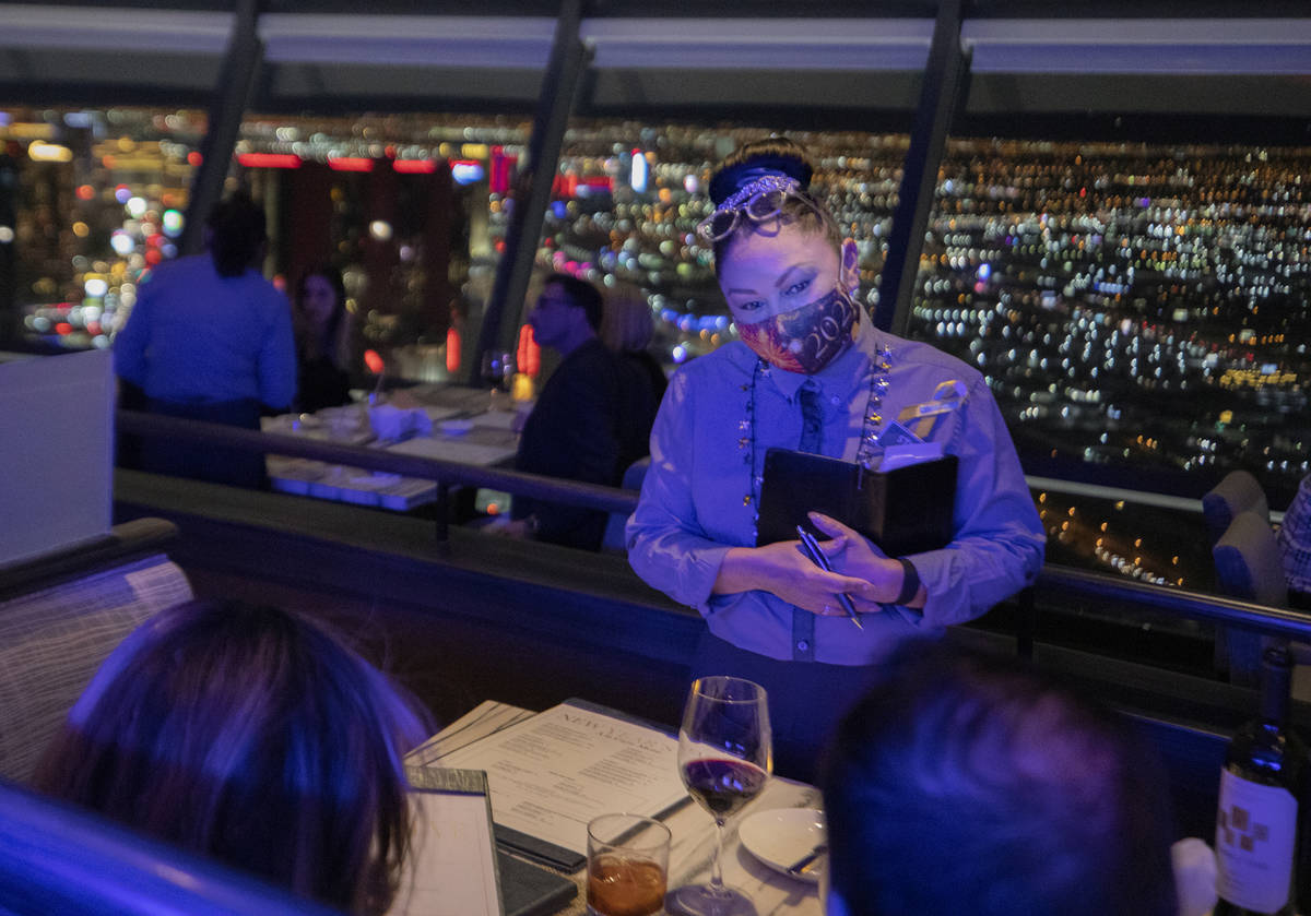 Server Armida Gonzalez takes guests orders at the Top of the World at the Strat onThursday, Dec ...