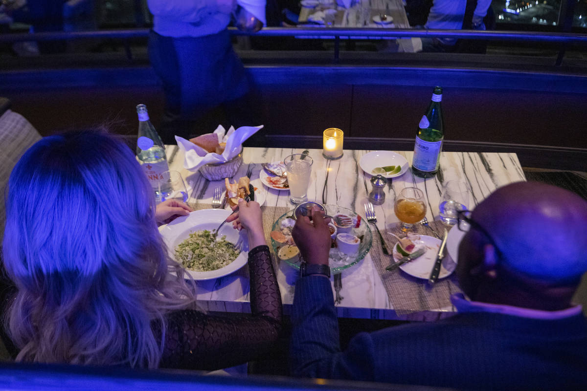 Guests dine at the Top of the World at the Strat on Thursday, Dec. 31, 2020, in Las Vegas. (Eli ...