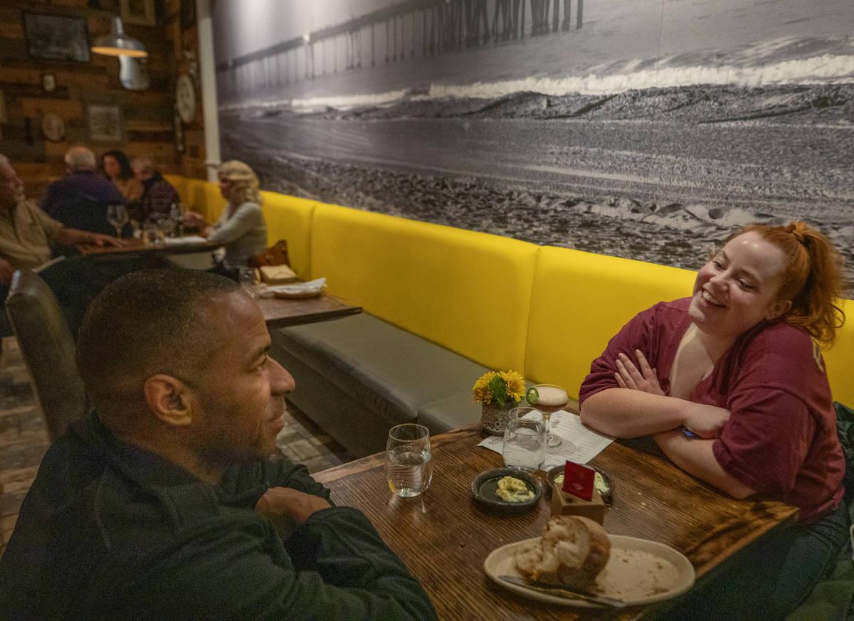 Ellis Brown, 43, of Atlanta, Georg., left, and Heather Snedeker, 30, of Las Vegas, dine at Esth ...