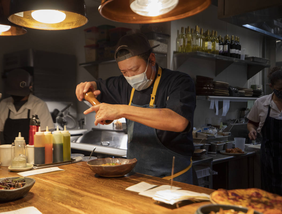 Chef Stephen Lee puts finishing touches on a course at EstherÕs Kitchen in downtown Las Ve ...