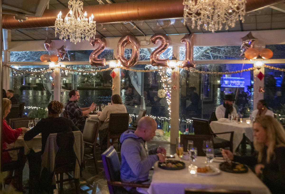 Individuals dine at Americana in Las Vegas on Thursday, Dec. 31, 2020. (Elizabeth Page Brumley/ ...