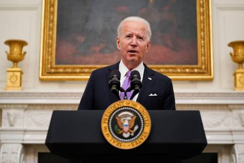 President Joe Biden speaks about the coronavirus in the State Dining Room of the White House, T ...