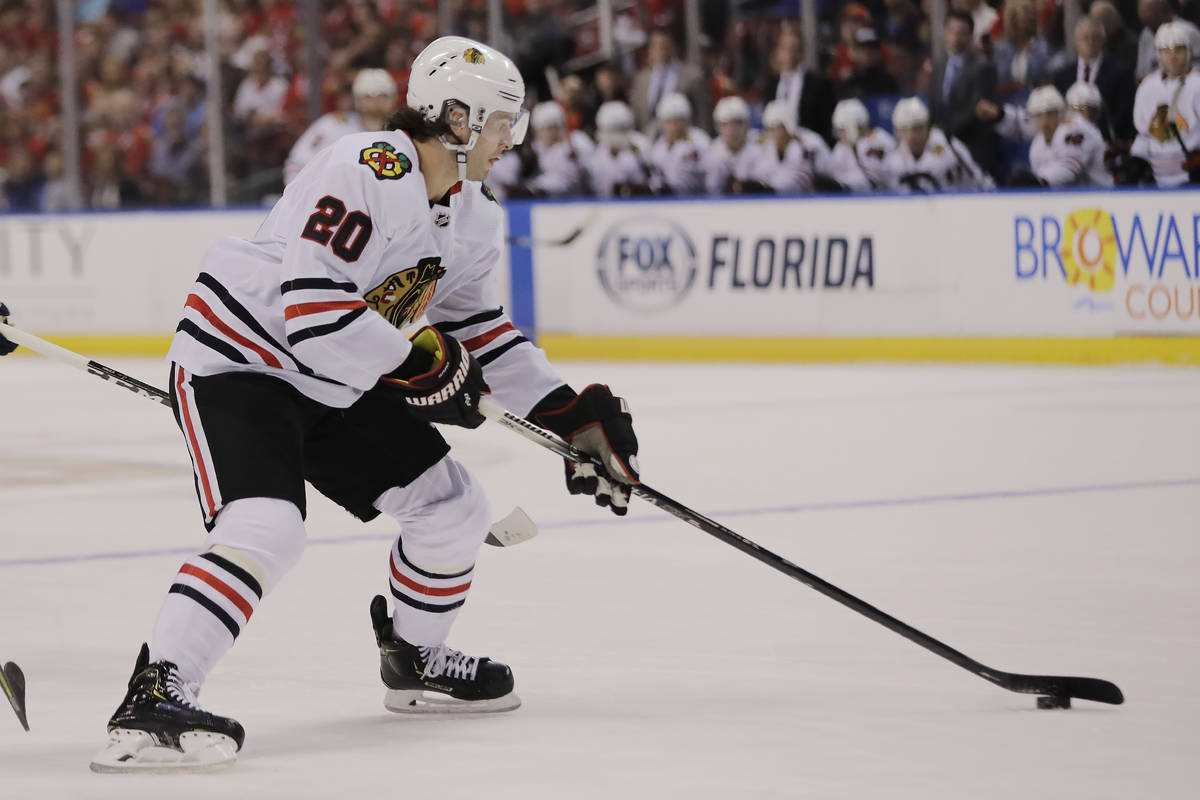 Chicago Blackhawks left wing Brandon Saad (20) skates with the puck during the first period of ...