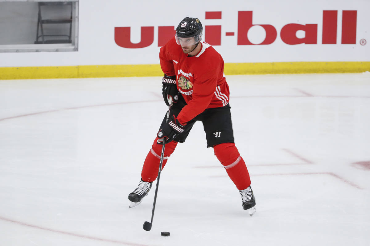 Chicago Blackhawks left wing Brandon Saad looks to pass the puck during NHL hockey practice at ...