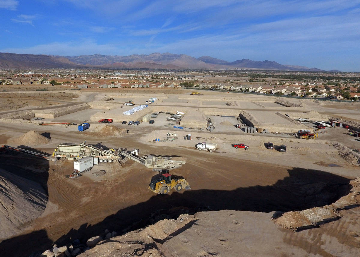 The Evora apartment complex site where a huge mixed-use complex is under construction is photog ...