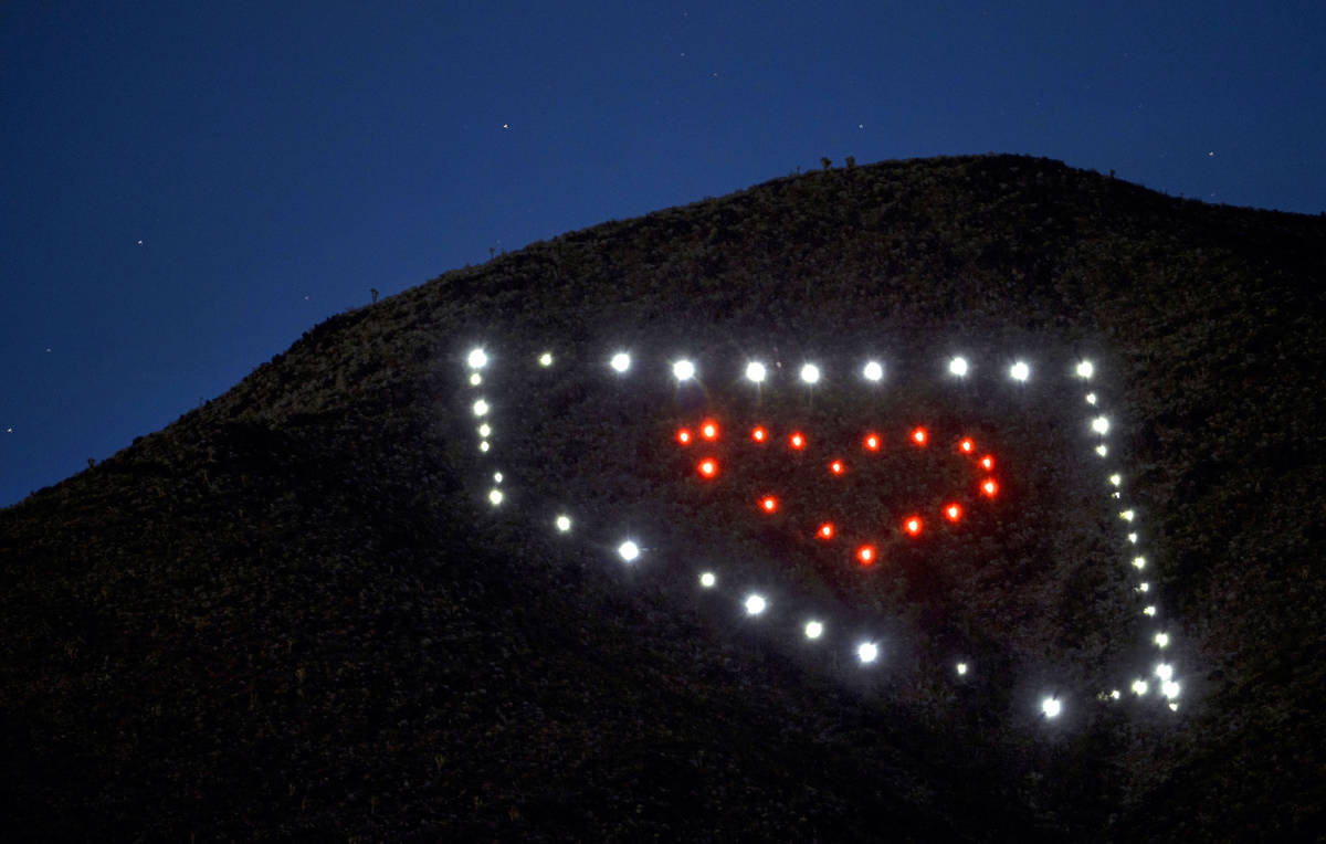 The solar lights shine brightly night falls about a Nevada light display atop of Black Mountain ...