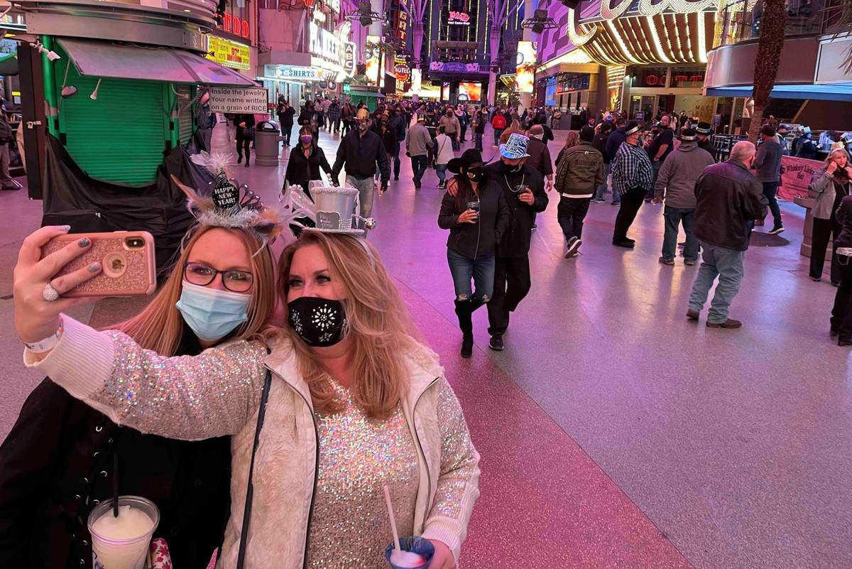 Sisters Christine, left, and Rebecca Loffert celebrate New Year's Eve at the Fremont Street Exp ...