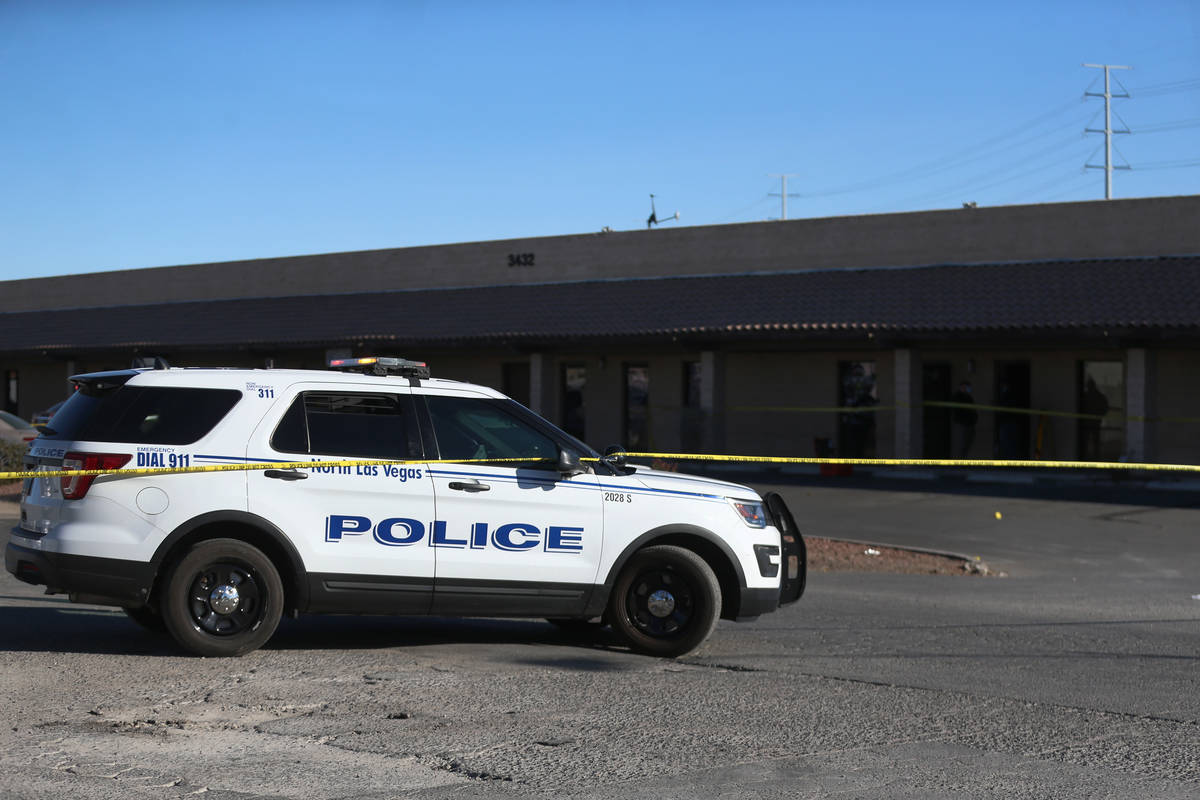 North Las Vegas police investigators work the scene of a fatal shooting near the intersection o ...