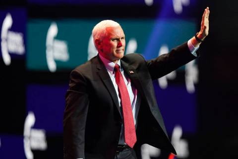 Vice President Mike Pence waves as he walks off the stage after speaking at the Turning Point U ...