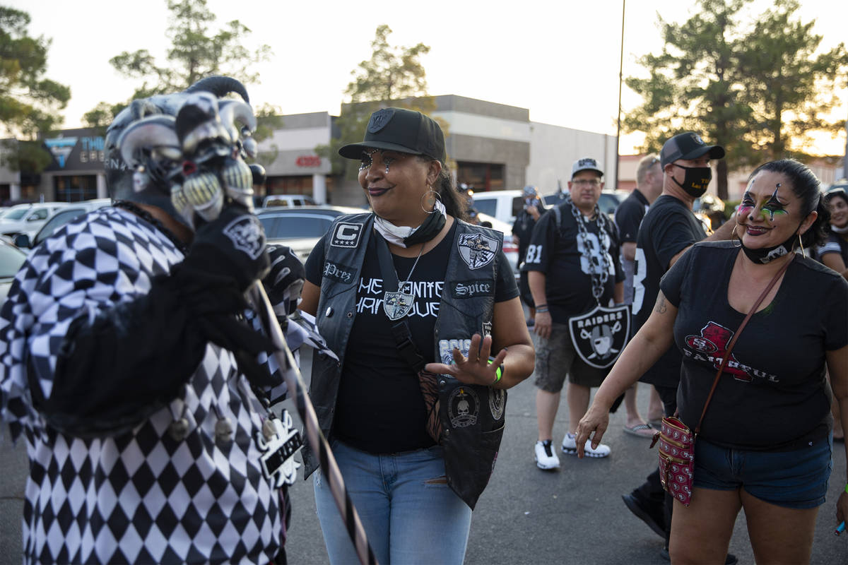 Raider Jester, left, whose name is Anthony Herrera, is shown at a Raiders party in Las Vegas on ...