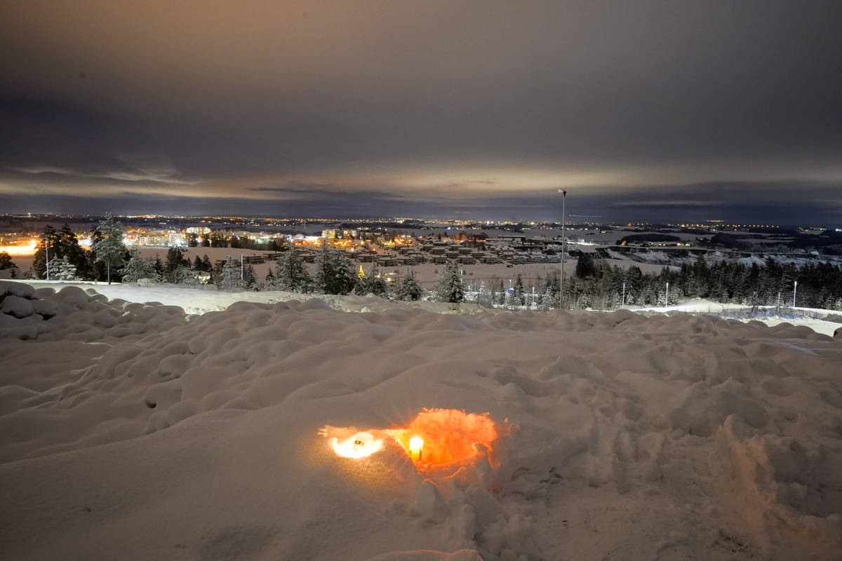 A candle burns on Saturday Jan. 2, 2021, for the victims of the massive landslide that hit the ...