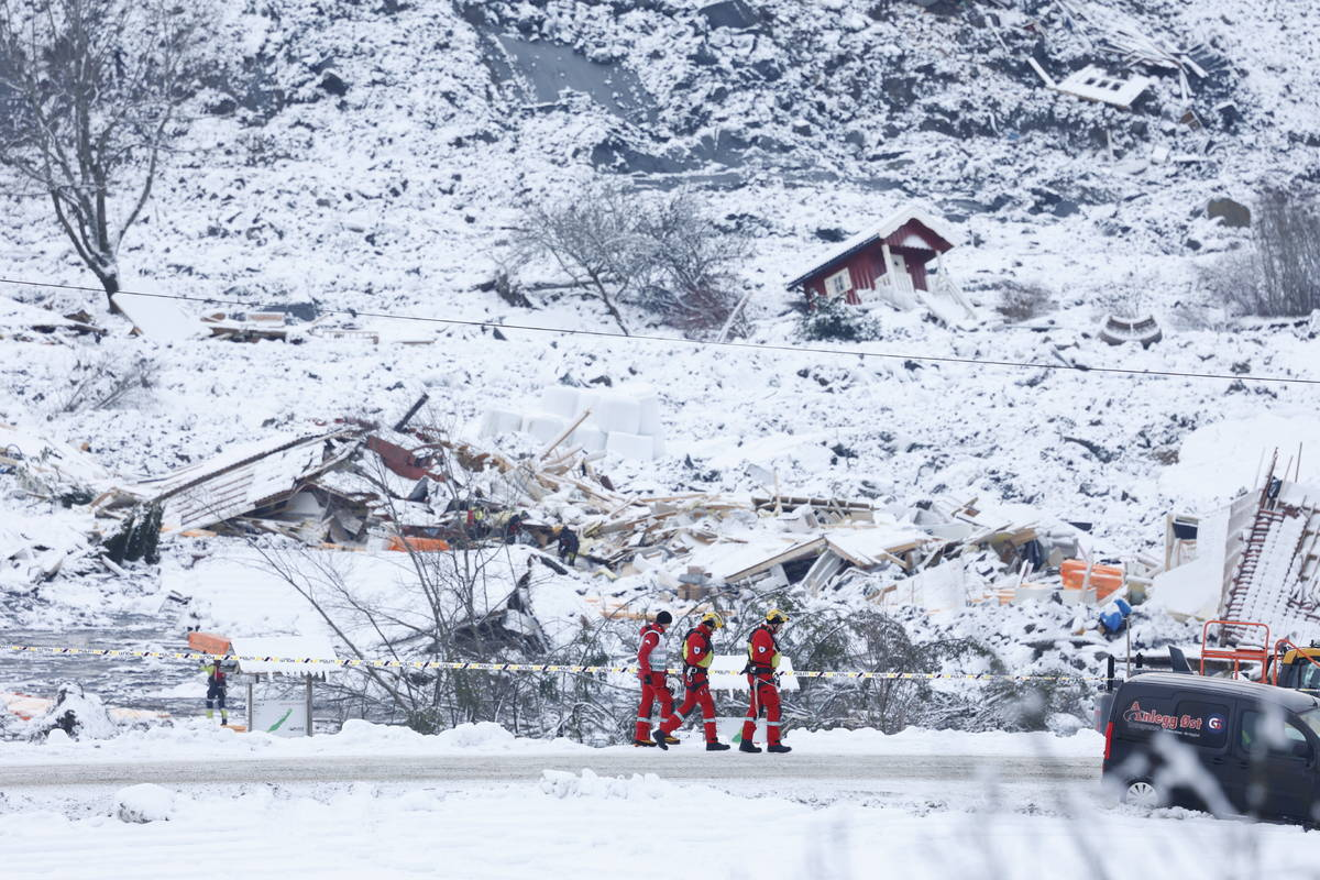 Rescue crews work in the area at Ask in Gjerdrum, Saturday Jan. 2, 2021, after a massive landsl ...